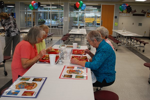 Guests enjoy delicious food prepared by our wonderful cafeteria staff!