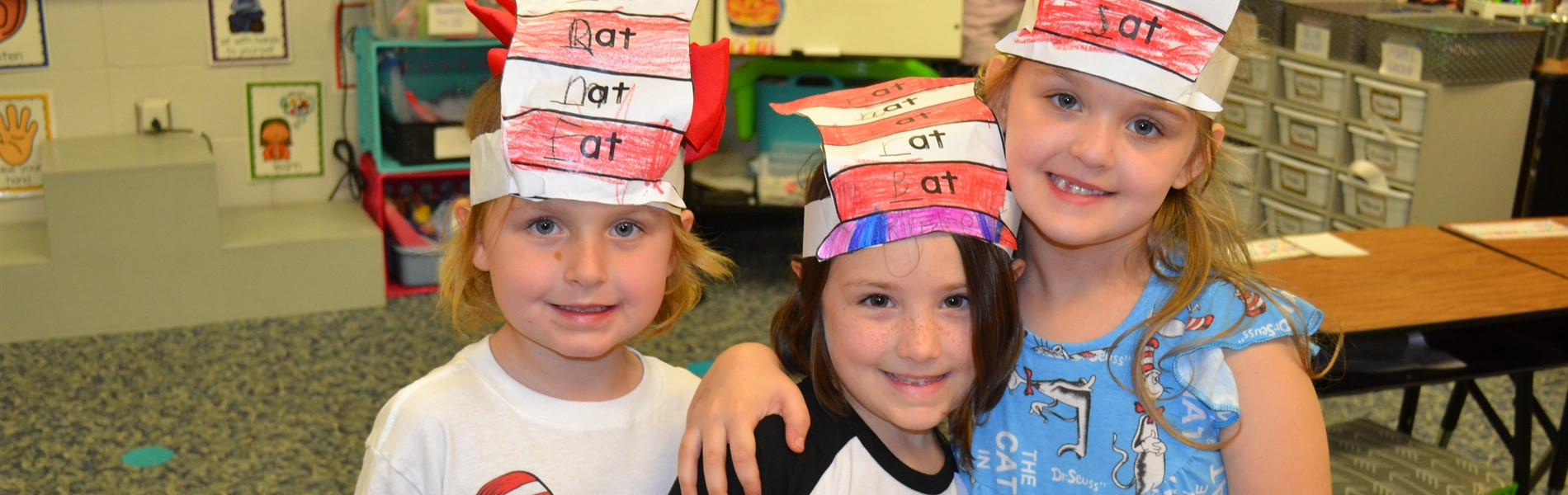 Dr. Seuss' birthday - kids wearing Cat in the Hat hats