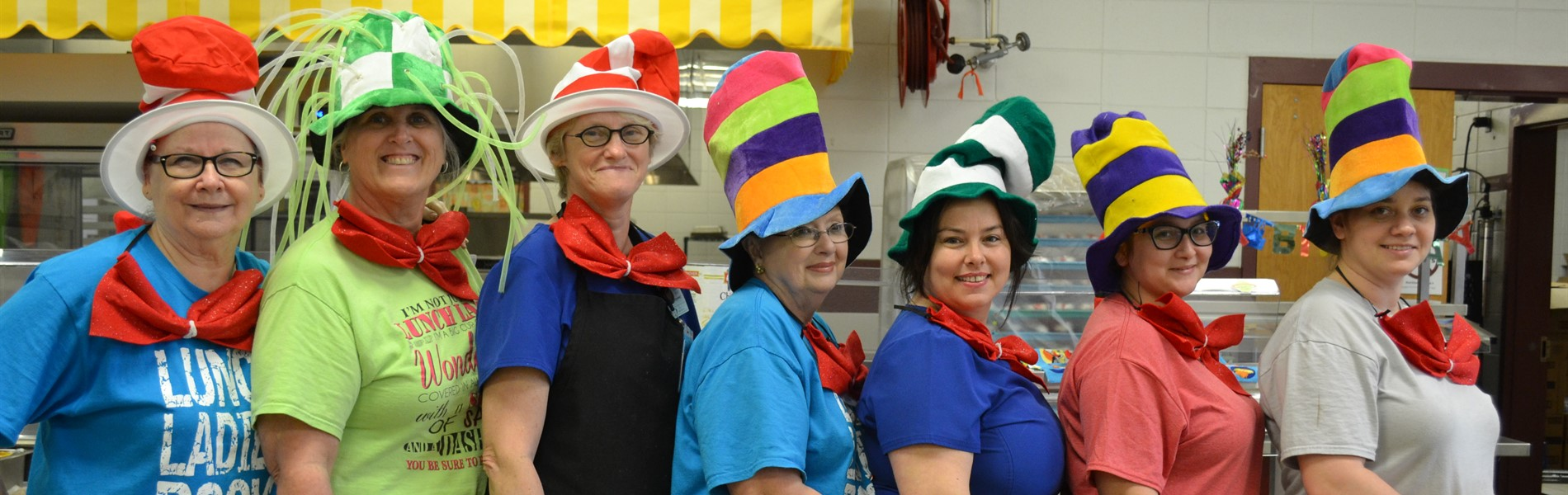 Cafeteria workers wearing Cat in the Hat hats