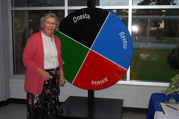 Mrs. Betty Knowlton spins the house wheel!